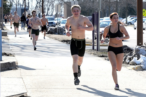 Runners make their way around campus during the Nearly Naked Mile Thursday at Minnesota State University. Runners donate their clothes to Again Thrift and More at the start of the run, now in its third year.