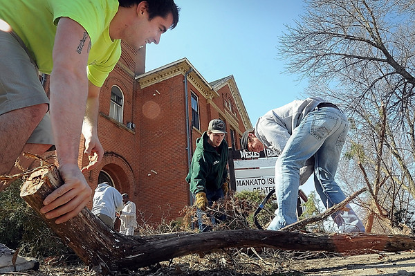 John Cross<br /> Matt Arford (left), David Feichtinger (center) and Parker Riegelman, all students at Minnesota State University, work at clearing shrubs Friday at the Islamic Center at 329 North Broad Street. The students were part of a community leadership class at MSU that took the chore on as a class project.