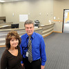 John Cross<br /> Brenda Andre, Central Registration coordinator, and Jerry Kolander, director of business affairs, are pictured in the Mankato Area Public Schools Central Registration office located in the old council chambers of the Intergovernmental Center.