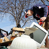 John Cross<br /> Nate Malacowsky, a student at South Central College, checks out a computer monitor placed curbside for North Mankato's annual spring garbage pick-up for its copper power cord.