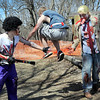 Jerry and Dave Wilson, dressed as zombie versions of the rock band Hall and Oates, can't grab a runner's flag as he leaps between them during Saturday's Mankato Zombie Run at Mount Kato.