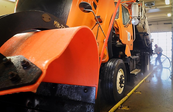John Cross<br /> A MnDOT worker washes the grime accumulated during last week's snowstorm from a plow truck in preparation of yet another storm that was expected to sweep across much of Minnesota Monday night and Tuesday morning.