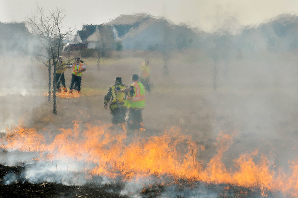 Workers perform a controlled burn on Benson Park in Upper North Mankato on Tuesday. Photo by John Cross