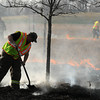 Crews tend to a controlled burn on Benson Park in Upper North Mankato on Tuesday. Photo by John Cross