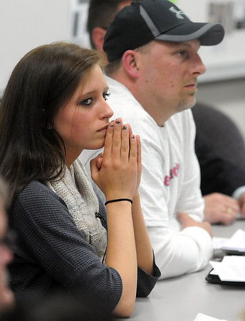 United South Central junior Alyssa Drescher and her father Rick listen to testimony during an expulsion hearing Thursday at United South Central High School. Drescher faces expulsion for a year after a pocket knife was found in a purse in her locker during a lockdown Apr. 15. Photo by Pat Christman