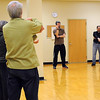 Matt Lauters leads a group through qigong movements during World Tai Chi and Qigong Day Saturday. Photo by Pat Christman