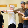 Matt Lauters describes proper form during World Tai Chi and Qigong Day Saturday at the St. Peter Community Center. Photo by Pat Christman