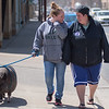 Maddie Exline (center) and Sanjay Roozen talk as they walk Lucy, a three-year old pet pig along Riverfront Drive on Friday. Exline said they were taking Lucy to Mom and Pop's for ice cream. Photo by Jackson Forderer