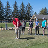 Mankato Loyola/St. Clair Golf coach Coltt Ullom instructs junior high golfers about chipping during practice Thursday at the Terrace View golf course. The 9-hole and par 3 course will open today. Photo by Jackson Forderer