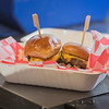 Cheeseburger sliders in a basket inside The 507 food truck. The 507 was one of four food trucks at the first day of the Hub. Photo by Jackson Forderer