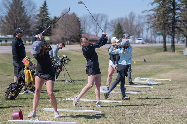 Gustavus women's golfers, from left, Jessica Nelson,  Kristen Cash and Mckenzie Swenson practice at the Terrace View driving range on Thursday. The practice range is used by college and high school teams. Photo by Jackson Forderer