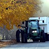 Mankato's leaf vacuum is surrounded by a cloud of dust as it cleans up a Mankato street this week.