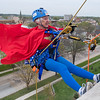 Margaret Gronstal, 88, leans out over the edge of the Vine building as he Wonder Woman cape blew in the wind. Gronstal, who raised $1,100 for the Vine building, rappelled down the building with her granddaughter Meghan Velasquez. Photo by Jackson Forderer