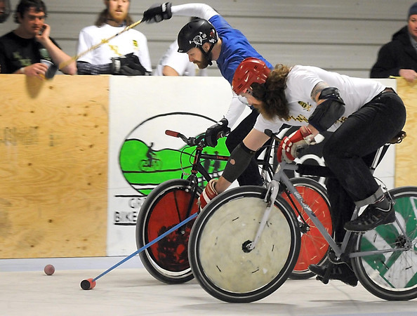 Mankato's Bruce Wahl winds up to take a shot during a bike polo match against Minneapolis during a bike polo tournament Saturday at the Mankato Curling Club.