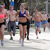 Barely-clad runners make their way around the Minnesota State University campus during the Nearly Naked Mile Wednesday. The event, in its second year, collects the clothing off the runners' backs to be donated to Again Thrift & More, a thrift store run by the Minnesota Valley Action Council.