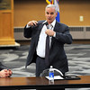Gov. Mark Dayton takes off his tie at the beginning of a town hall meeting answering questions about his proposed budget Tuesday at South Central College. With Dayton is Mankato mayor Eric Anderson, left, and Minnesota Department of Health and Human Services commissioner Lucinda Jesson.