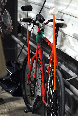 A bike and mallets wait for the next match during Saturday's tournament.