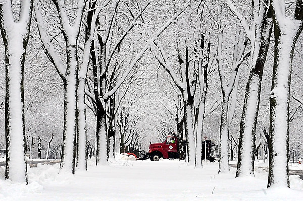 John Cross<br /> A Mankato city snowplow clears side streets along Broad Avenue on Thursday in a picture postcard-pretty scene. Pretty thought it may have been, the heavy wet snow created hazardous driving conditions and prompted schools across the area to cancel classes.