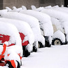 John Cross<br /> Lawn tractors for sale at a Mankato retailer are cloaked in a heavy blanket of snow in the wake of Thursday's spring snowstorm.