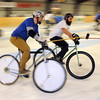 Mankato's Andy Dowd (blue shirt) charges after the ball during a bike polo match against Minneapolis Saturday at the Mankato Curling Club.