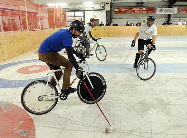 Mankato's Joe Rstom corrals the ball in the corner during their bike polo match Saturday.