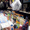 Pepsi distributor Bill Schumacher is surrounded by some of the company's products as he talks to visitors at the Greate rMankato Business Showcase Tuesday at the Verizon Wireless Center.