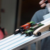 Pinewood derby cars streak down the track during Saturday's race.  Photo by Pat Christman