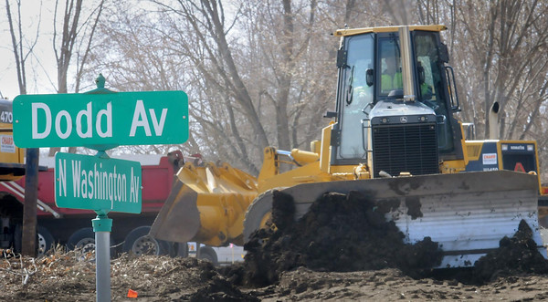 Construction equipment works at the point where a North Washington Avenue re-alignment will intersect with Dodd Avenue in St. Peter. Photo by John Cross