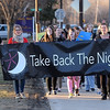Marchers walk along the Minnesota State University campus as part of a Take Back the Night rally to raise awareness of sexual violence Tuesday evening.  Photo by Pat Christman