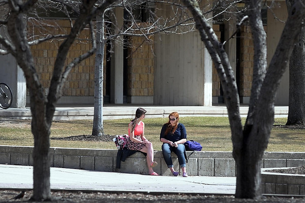 A pair of Minnesota State University students enjoy a nice spring day on the campus mall Wednesday.  Photo by Pat Christman