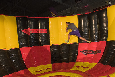 Ryan Schmitz, a participant in the Kato Ninja Warrior held by the Student Event Team at Minnesota State, runs through an obstacle called the Vortex. Participants tried to use their speed and centrifical force to stay above the dotted line as they went through the obstacle course. Schmitz finished in ninth place in the time trials. Photo by Jackson Forderer