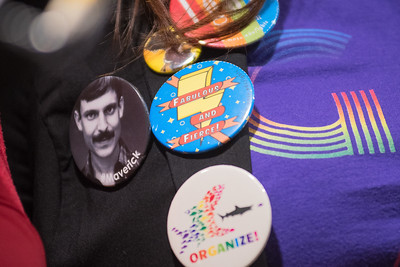 Buttons on Jenn Saunders' vest include a button of Jim Chalgren (left) whom many gave praise to at the 40th anniversary of the LGBT Center at Minnesota State.  Chalgren was an outspoken advocate for LGBT rights and was instrumental in starting the Center in 1977. Photo by Jackson Forderer