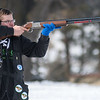 Jackson Gibbs takes aim at a clay pigeon at the Caribou Gun Club in rural Le Sueur on Wednesday. Gibbs, a 9th grader at Cleveland High School, won the 4-H trap shooting tournament last fall. Photo by Jackson Forderer