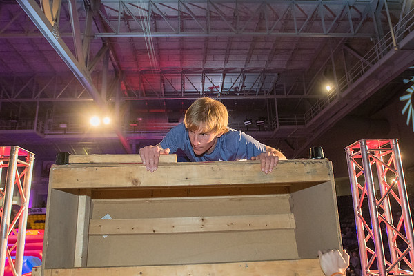 Ethan Kurtz climbs up the last portion of the last obstacle, the warped wall, on the Kato Ninja Warrior course in Bresnan Arena on Friday. Kurtz finished in 13th place in the time trials. Photo by Jackson Forderer
