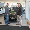 Jason True (left) talks with Peter Gieseke in the show room at Mankato Motors on Friday. Mankato auto dealers sold 11,388 vehicles in 2017, up a solid 7.5 percent from the year before. Photo by Jackson Forderer