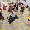 Christopher Blount (center) and other Mankato East students practice a dance backstage for the upcoming play Tarzan. Photo by Jackson Forderer