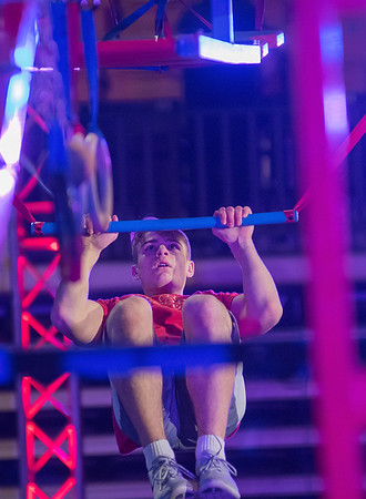 Charlie Becker swings through the Kato Ninja Warrior obstacle course, held at Bresnan Arena on Friday. Becker finished in third place in the time trials. Photo by Jackson Forderer