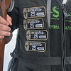 Patches on Jackson Gibbs' shooting vest show the times he has scored a 25, or a perfect score, while trap shooting. Photo by Jackson Forderer