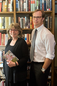 Deborah and Brian Fors at their home in Mankato. The Fors are founding a publishing company called Minneopa Valley Press. Deborah is holding a book by their first signed author, Nicole Helmet. Photo by Jackson Forderer