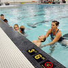 John Cross<br /> Swimming instructor Meghan Petersen works with students during a Community Education and Recreation swimming lesson at the East High School pool, which was deepened and once again can be used for high school meets.