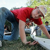 John Cross<br /> ZAP Camper Carter Eisinger offers a steadying hand Thursday as teammates pour water into a device they constructed to simulate a flooding stream, The exercise which was part of an three-day engineering camp challenged to students to come up with ways to stabilize a creek bed and slow run-off.