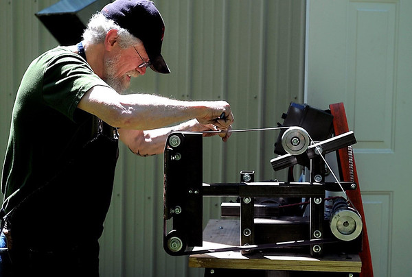 Knife maker Roger Cook puts the finishing touches on a hand made handle for a knife during a Hammer In Saturday at Midwest Knifemakers Supply in North Mankato.