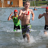 Ironkids competitors race from the Spring Lake Park pool to the bike-riding leg of the triathlon.