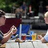 John Cross<br /> Todd and Mara Olson of Blue Earth soaked up some sunshine and suds while listening to music at Ribfest.