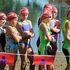 Young competitors line up for the swimming portion of the Ironkid Triathlon at Spring Lake Park on Saturday.