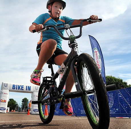 A rider mounts his bike for the riding portion of the Ironkids Triathlon.