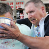 Blue Earth County Commissioner Vance Stuehrenberg gives Mankato Mayor Eric Anderson an extra dose of apple pie at the conclusion of a pie-earting contest at the Blue Earth County Fair on Saturday.