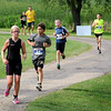 Ironkids runners run the homestretch of triathlon at Spring Lake Park on Saturday.