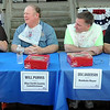 From left, KEYC news anchor Eric Lind, Blue Earth County Commissioners Drew Campbell and Will Purvis, Mankato Mayor Eric Anderson , Blue Earth County Commissioner Vance Stuehrenberg and Lake Crystal Mayor Brad Ahrenstorff prepare to square off in a pie-eating contest at the Blue Earth County Fair on Saturday.
