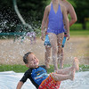 With temperatures in the 80s, a slip-and-slide was a popular attraction for Reece Kenison and other youngsters attending the Night to Unite End of Summer Celebrationi at St. Peter's Veteran's Memorial Park on Tuesday.